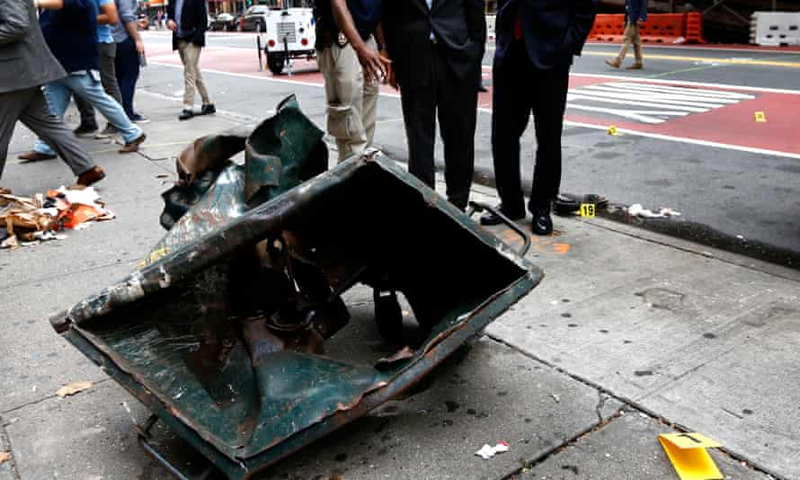 A dumpster mangled by an explosion in New York.
