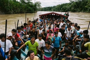 Close to 150 Wampis warriors head towards an illegal gold mining site on the Santiago river