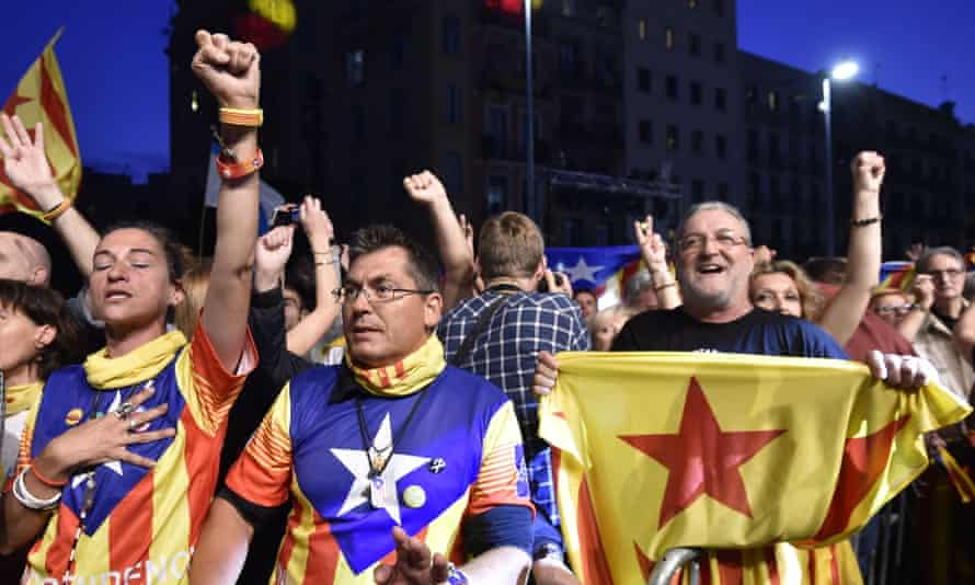 Catalan pro-independence supporters following the closing of polling stations during Catalan regional elections.