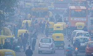 Commuters on a polluted road near a bus terminus in the Anand Vihar district of New Delhi.