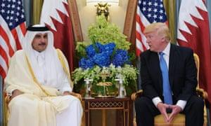 Donald Trump speaks with Qatar's Emir Sheikh Tamim Bin Hamad Al-Thani during a bilateral meeting at a hotel in the Saudi capital Riyadh last month.