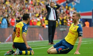 Mertesacker celebrates with Santi Cazorla whilst Villa boss Tim Sherwood can only put his head in his hands.