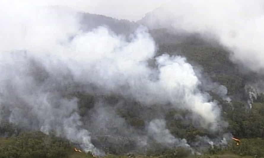 Fire and smoke rise from a bushfire in the Blue Mountains, NSW, on Sunday.