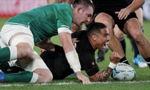 New Zealand scrum-half Aaron Smith scores the opening try against Ireland during the quarter-final at Tokyo Stadium.