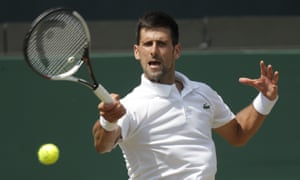 Novak Djokovic plays a forehand return during his second-round match against the Czech Republic's Adam Pavlasek.
