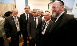 London's newly elected mayor Sadiq Khan stands with holocaust survivor Ben Helfgott (2nd R), Britain's Chief Rabbi Ephraim Mirvis (R), and Israel's ambassador to Britain Mark Regev (2nd L)