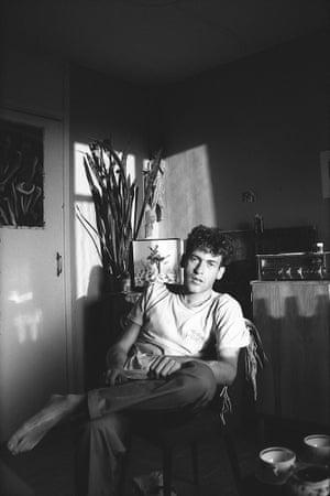 A man lounges around in a Soviet kitchen