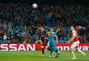 Lionel Messi of Barcelona scores his team's third goal.