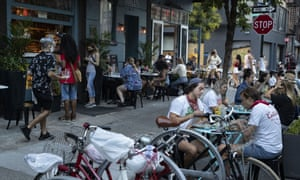 Customers dine outside Dudley's in New York last week. Mayor Bill de Blasio says he is delaying the planned resumption of indoor dining at restaurants in the city, fearing it would ignite a spike in coronavirus infections.