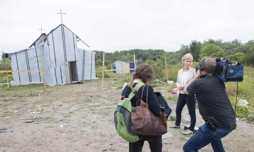 Presenter Sally Magnusson and a Songs of Praise film crew outside a makeshift church in a Calais refugee camp in August 2015