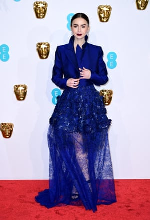 Lily Collins was one of the few stars who sensibly wrapped up against the chilly temperatures on the red carpet, wearing a couture dress by Givenchy