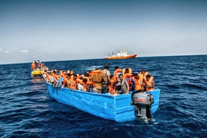 A boat full of migrants being rescued by the Aquarius