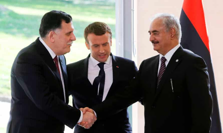 Macron brokers a meeting between warring factions in Libya.