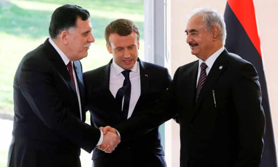 Emmanuel Macron, centre, with Sarraj and Haftar after talks aimed at easing tensions.