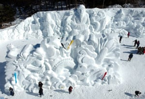 Taebaek, South Korea: Visitors view large snow sculptures at the Mount Taebaek snow festival in the city