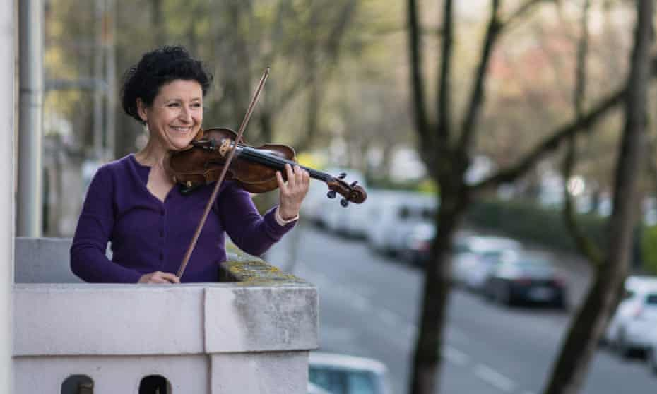 Mulhouse Symphonic Orchestra violinist Jessy Koch performs on her balcony to support health workers in Mulhouse, eastern France.