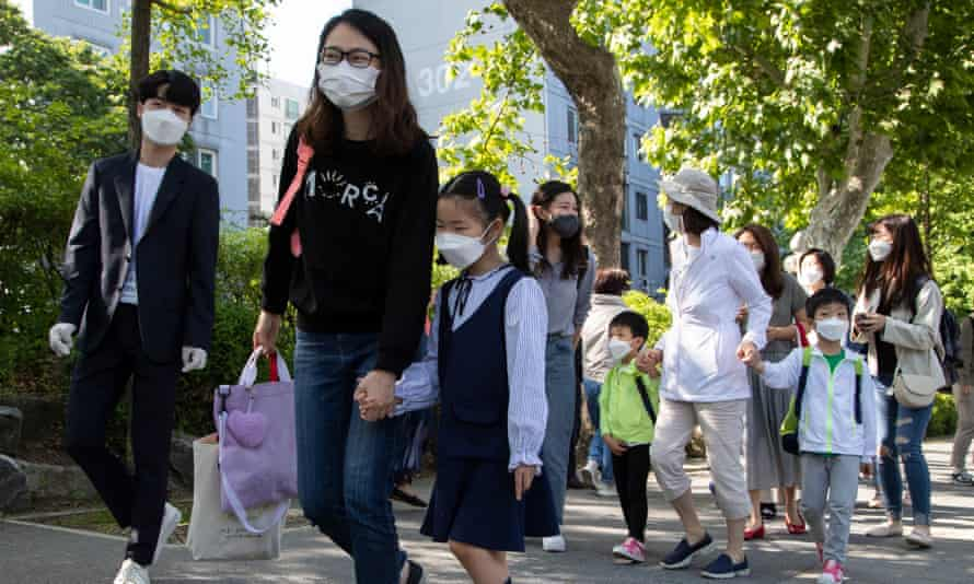 Pupils return to school in Seoul, South Korea, 27 May