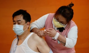 Second batch of COVID19 vaccination in Taiwan<br>epaselect epa09130019 A medical worker administers a jab of Vaxzevira (formerly AstraZeneca) COVID-19 vaccine in Taoyuan city, Taiwan, 12 April 2021. Taiwan started administering the second batch of COVID-19 vaccine that arrive in the country on 04 April 2021 under COVAX initiative.  EPA/RITCHIE B. TONGO