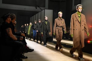 Models walk the runway during the finale of the Dior Homme menswear show in Paris.