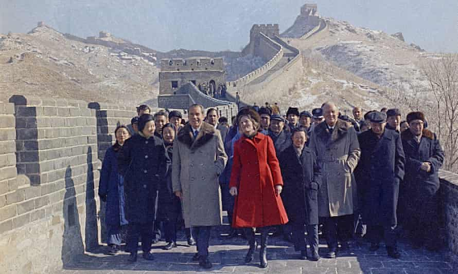 President Richard Nixon and first lady Pat Nixon lead the way as they take a tour of China's Great Wall, near Beijing, February 1972.