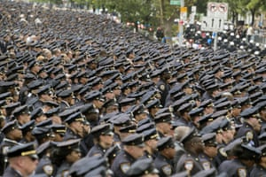 New York, United StatesPolice officers stand at attention at the funeral of police officer Miosotis Familia