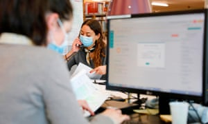 People work in a call centre of Covidom, a new remote medical monitoring app, in Paris.
