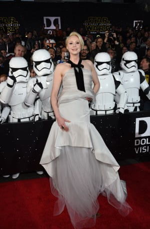 Gwendoline Christie (Captain Phasma) in layers of grey-white and a loose black bowtie, colour co-ordinating with her Stormtrooper fans.