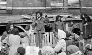 Eddie Africa uses public address system to talk to people outside the MOVE headquarters, a house in west Philadelphia, March 3, 1978.