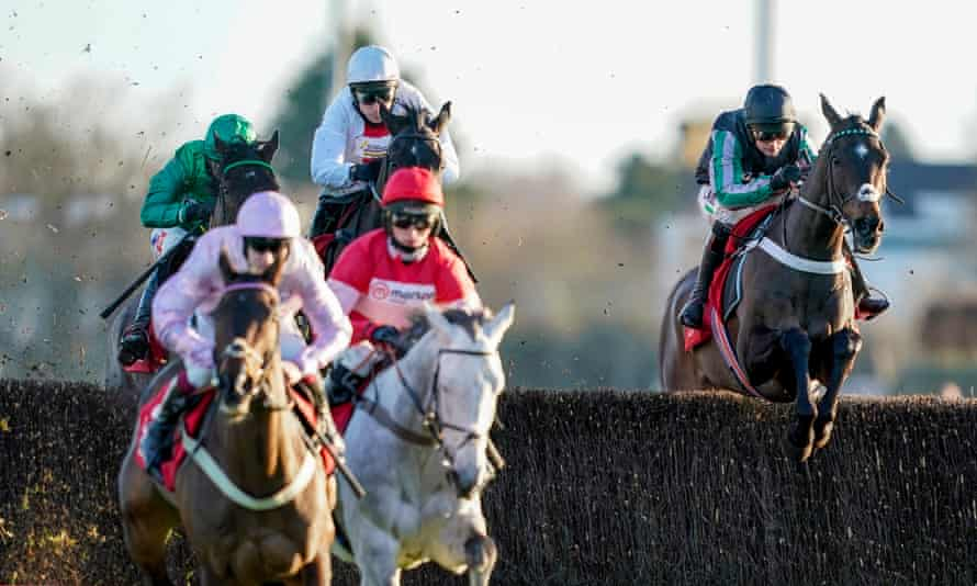 Nico de Boinville riding Altior (right) on their way to finishing second in the Desert Orchid Chase at Kempton.