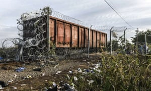 A railway wagon covered in barbed wire at the Hungarian border with Serbia