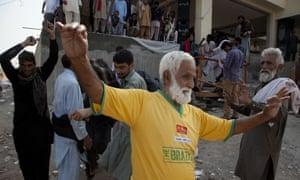 An Imran Khan supporter celebrates