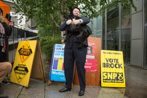 Scottish Conservatives leader Ruth Davidson casting her vote along with partner Jen Wilson and their dog at Café Camino polling station, near the St James Centre in Edinburgh