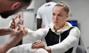 Ronda Rousey has her hands wrapped backstage.
