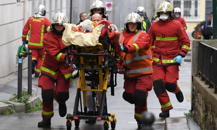 Firefighters attend to one of the victims of Friday's attack.