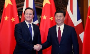 China's Xi Jinping shakes hands with David Cameron