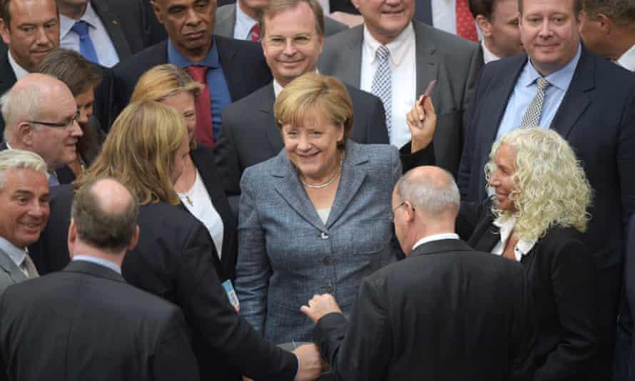 German MPs, including chancellor Angela Merkel, centre, in the Bundestag