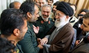Iran's supreme leader Ayatollah Ali Khamenei greets a group of Revolutionary Guard officers last week.