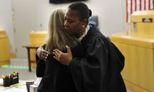 Judge Tammy Kemp gives former Dallas police officer Amber Guyger a hug before Guyger leaves for jail on 2 October 2019 in Dallas.