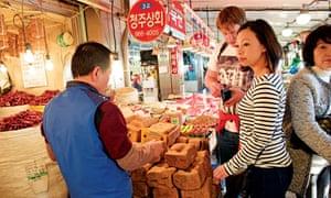 Shopping at a market in Busan, South Korea.