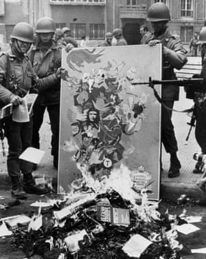 Soldiers burn Marxist books and leaflets in downtown Santiago in September 1973, following Chile's military coup.