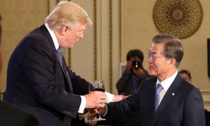 South Korean President Moon Jae-in makes a toast with Donald Trump at a state banquet in Seoul.