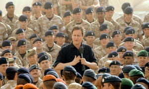 David Cameron speaks to British forces at Camp Bastion in Helmand Province in Afghanistan in June 2011
