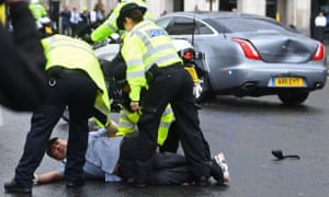 Police detain a man after the incident outside parliament