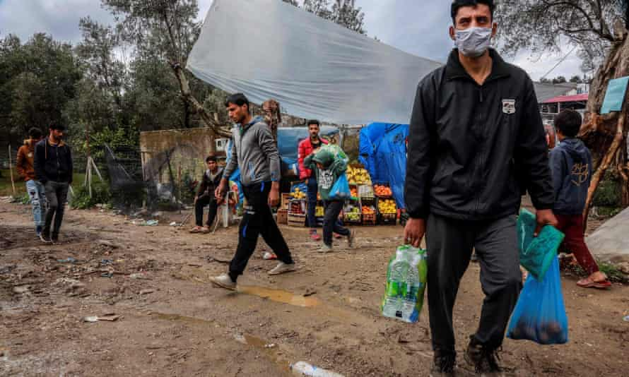 Refugees at a makeshift camp bordering the Moria camp in Lesbos, Greece, April 2020