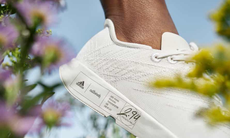 Shown is the Allbirds white sneaker collaboration with Adidas, showing a label with its carbon footprint.