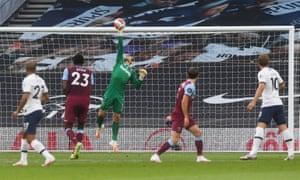 West Ham keeper Lukasz Fabianski paws away Lucas Moura's shot.