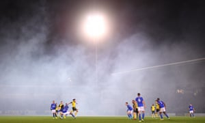 Leicester and Burton players play amid the fog.