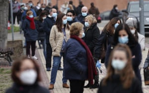 People wait in line for Covid tests in Madrid