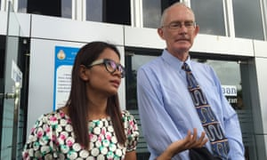 Alan Morison, right, Australian editor of the website Phuketwan and his colleague Chutima Sidasathien speak to the media ahead of their appearance in court to face charges of violating Thailand's Computer Crime Act in Phuket, Thailand.