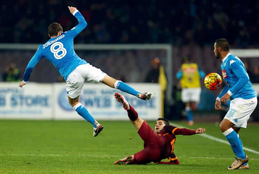 Jorginho, left, with Roma's Iago Falque.
